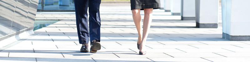 walking coaching man and woman